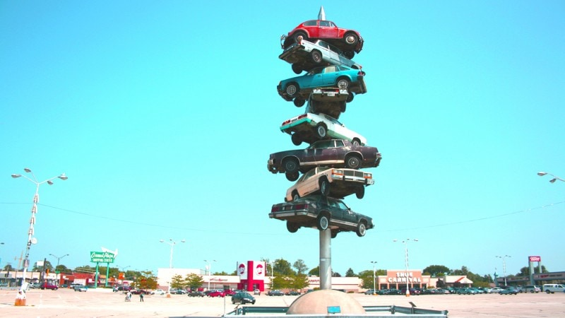 The Spindle in Berwyn, Illinois. Also known as cars on a spike or the car kabob. This roadside attraction was torn down in 2008.