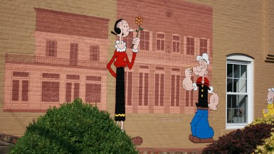 Popeye Mural in Chester, Illinois shows Popeye and Olive Oyl.