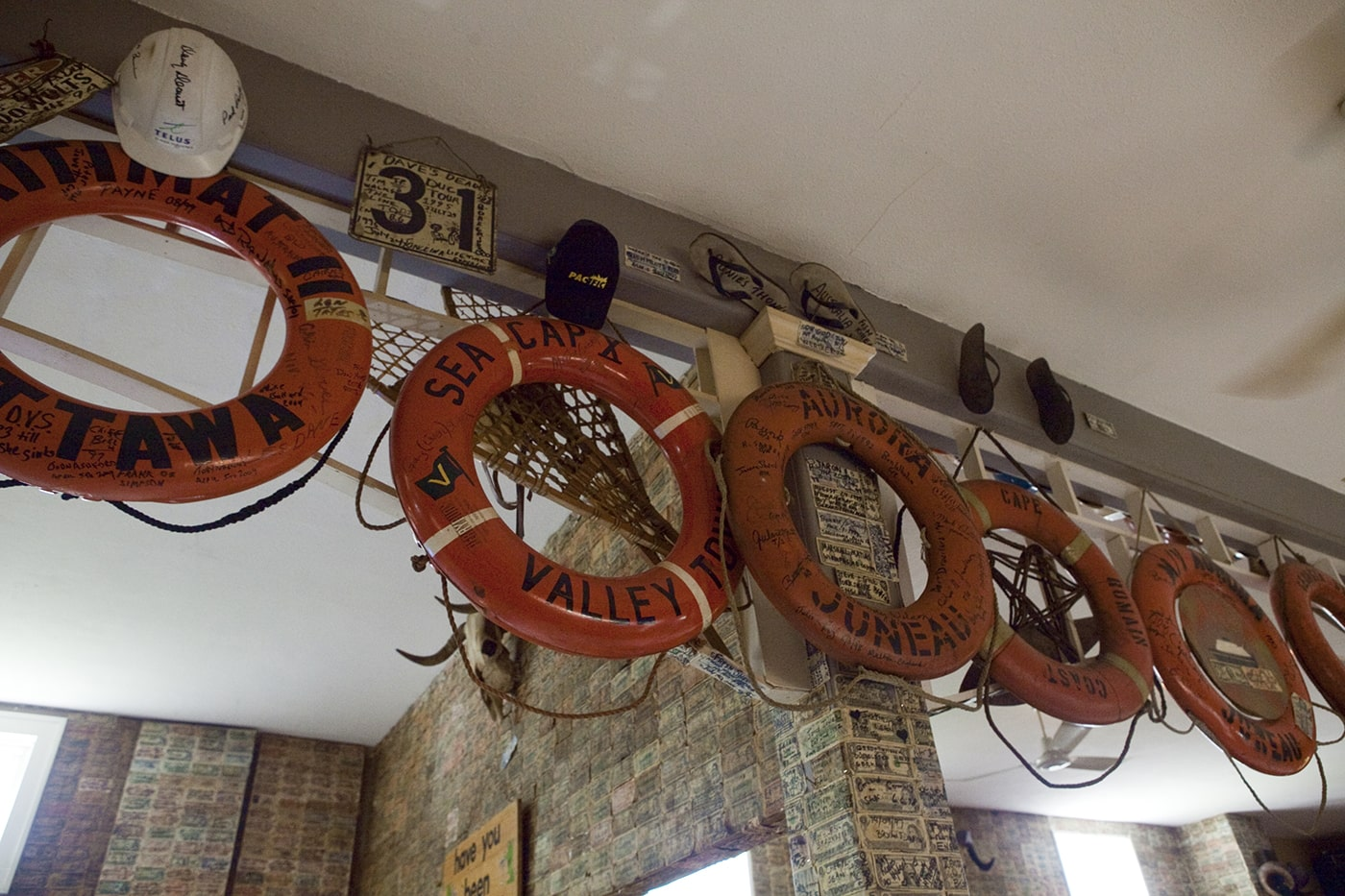Life preservers hang on the walls of the Glacier Inn in Hyder, Alaska.