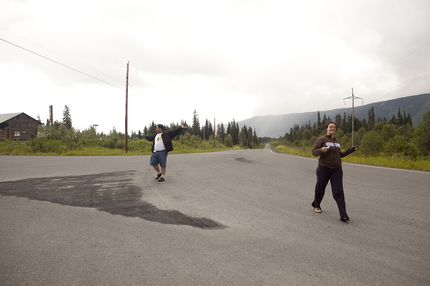 Playing in the middle of the highway at the Meziadin Junction, a Hyder, Alaska Visitor Information Center, in British Columbia, Canada.