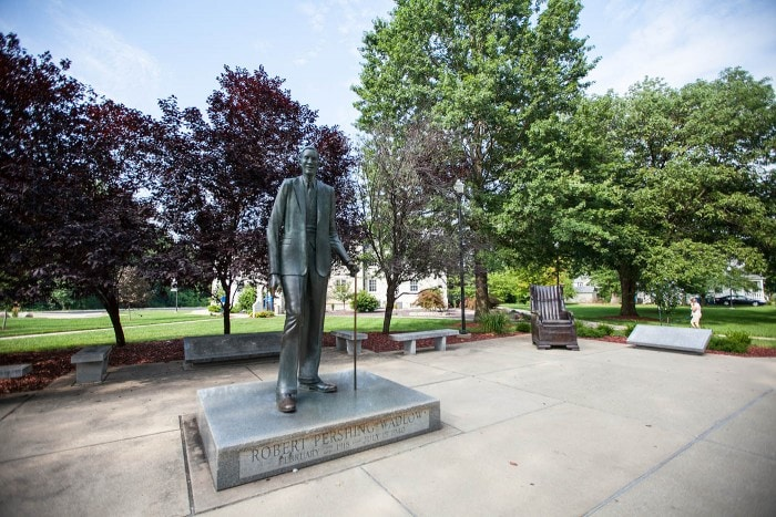 Best Illinois roadside attractions: Robert Wadlow Statue of the world's tallest man in Alton, Illinois. Visit this roadside attraction on an Illinois road trip with kids or weekend getaway with friends. Add the Robert Wadlow statue to your road trip bucket list and visit them on your next travel adventure.