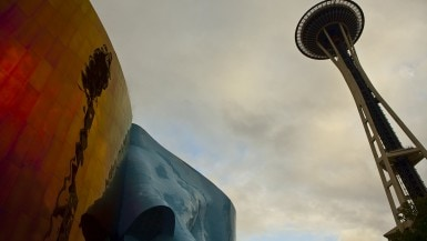 The Space Needle reflected off of off of Experience Music Project in Seattle, Washington.