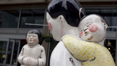 Young Woman, Girl, Mother and Child - a statue by Akio Takamori outside of a Whole Foods in Seattle, Washington.