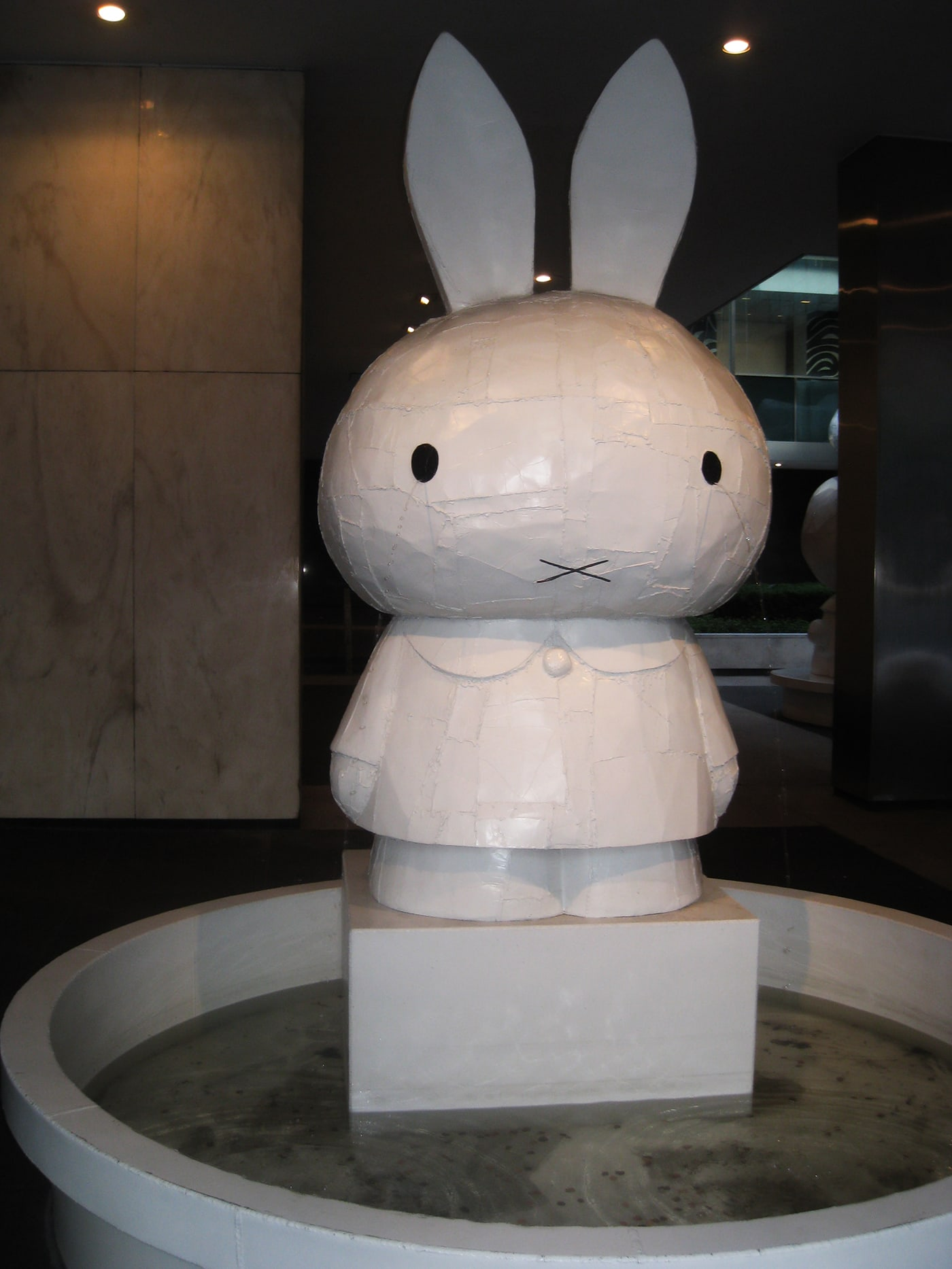 Miffy Hello Kitty Statues at the Lever House Art Collection in New York City.
