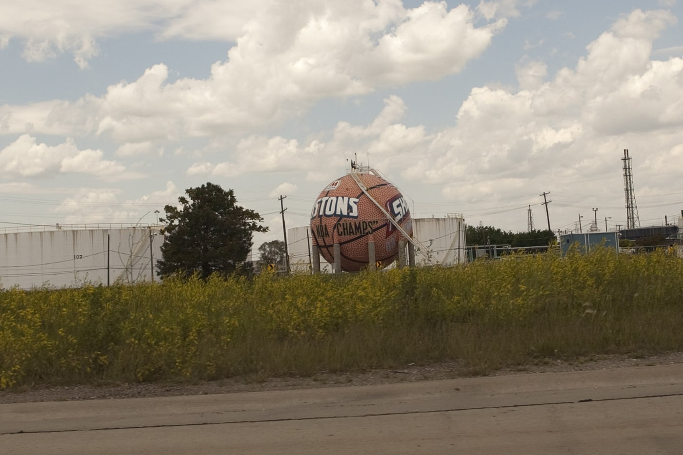 Giant basketball painted with the Detroit Pistons and WNBA Detroit Shock team logos, outside of Detroit, Michigan.