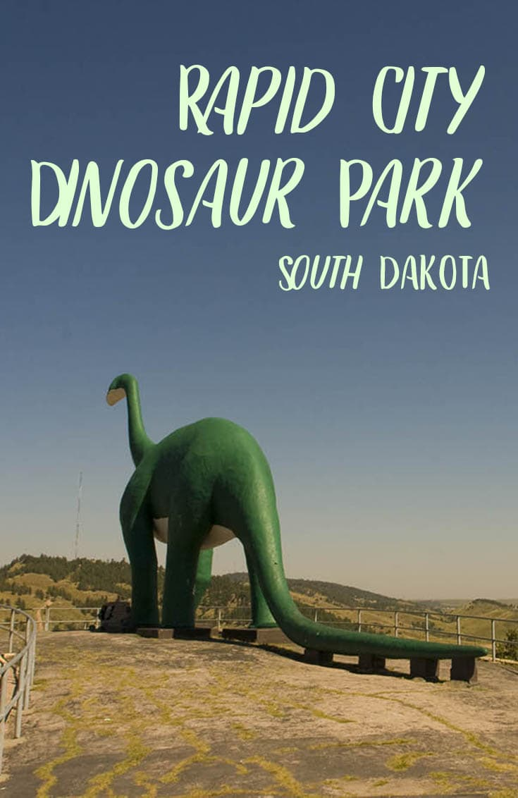 Photos of Rapid City Dinosaur Park - a park full of green and white dinosaur sculptures in Rapid City, South Dakota. It's a JURASSIC roadside attraction! Stop at this travel destination on the way to Crazy Horse, the Black Hills, or Mount Rushmore on a South Dakota road trip with kids, family, or friends. #SouthDakotaRoadsideAttractions #SouthDakotaRoadsideAttraction #RoadsideAttractions #RoadsideAttraction #RoadTrip #SouthDakotaRoadTrip #ThingsToDoInSouthDakota #WeirdRoadsideAttractions