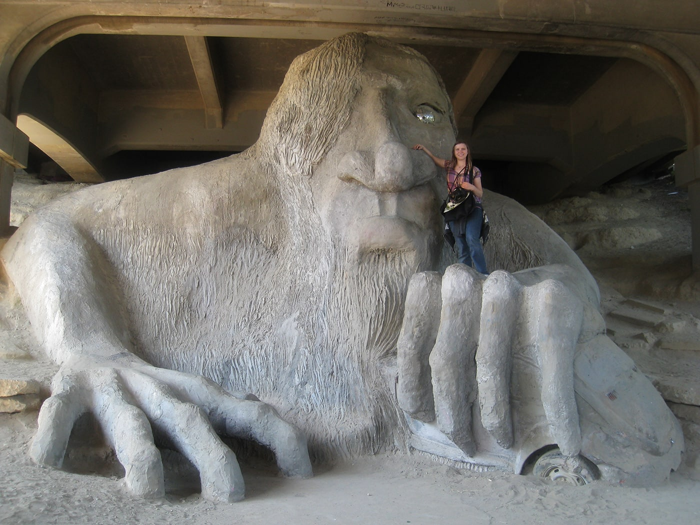 Val and the Fremont Troll, a roadside attraction in Seattle, Washington.