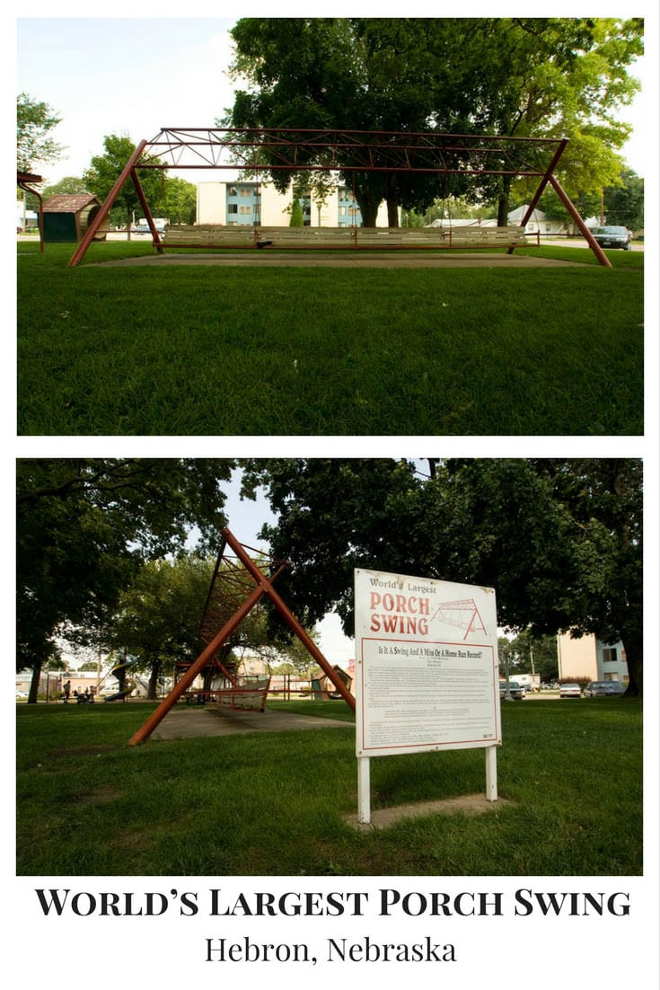 Photos of the world's largest porch swing in Hebron, Nebraska - at 32 feet wide the weird roadside attraction seats 18-24. Swing by on your Nebraska road trip! Add this travel destination to your road trip itinerary and travel bucket lists as a place to see as you road rip through Nebraska. #NebraskaRoadsideAttractions #NebraskaRoadsideAttraction #RoadsideAttractions #RoadsideAttraction #RoadTrip #NebraskaRoadTrip #ThingsToDoInNebraska #ThingsToSeeInNebraska #WeirdRoadsideAttractions