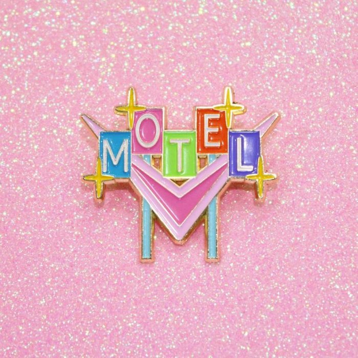 Retro Motel Sign Enamel Pin by Merch Motel | 50 Best Road Trip Gift Ideas for Road Trip Travelers