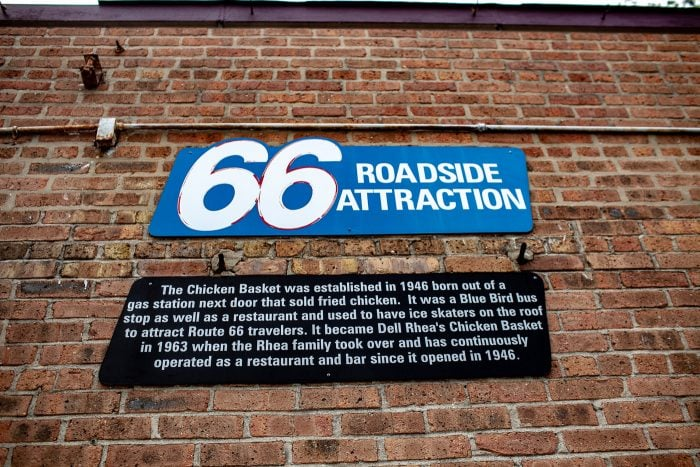 Dell Rhea's Chicken Basket sign - Route 66 roadside attraction: The Chicken Basket was established in 1946 born out of a gas station next door that sold fried chicken. It was a Blue Bird bus stop as well as a restaurant and used to have ice skaters on the roof to attract Route 66 travelers. It became Dell Rhea's Chicken Basket in 1963 when the Rhea family took over and has continuously operated as a restaurant and bar since it opened in 1946.