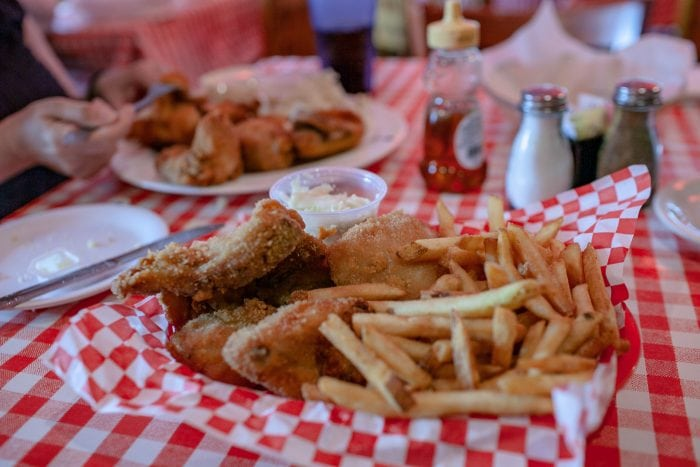 Famous Fried Chicken in a Basket - half fried chicken, French fries, homemade cole slaw and freshly baked biscuits at Dell Rhea's Chicken Basket restaurant on Route 66 in Illinois.
