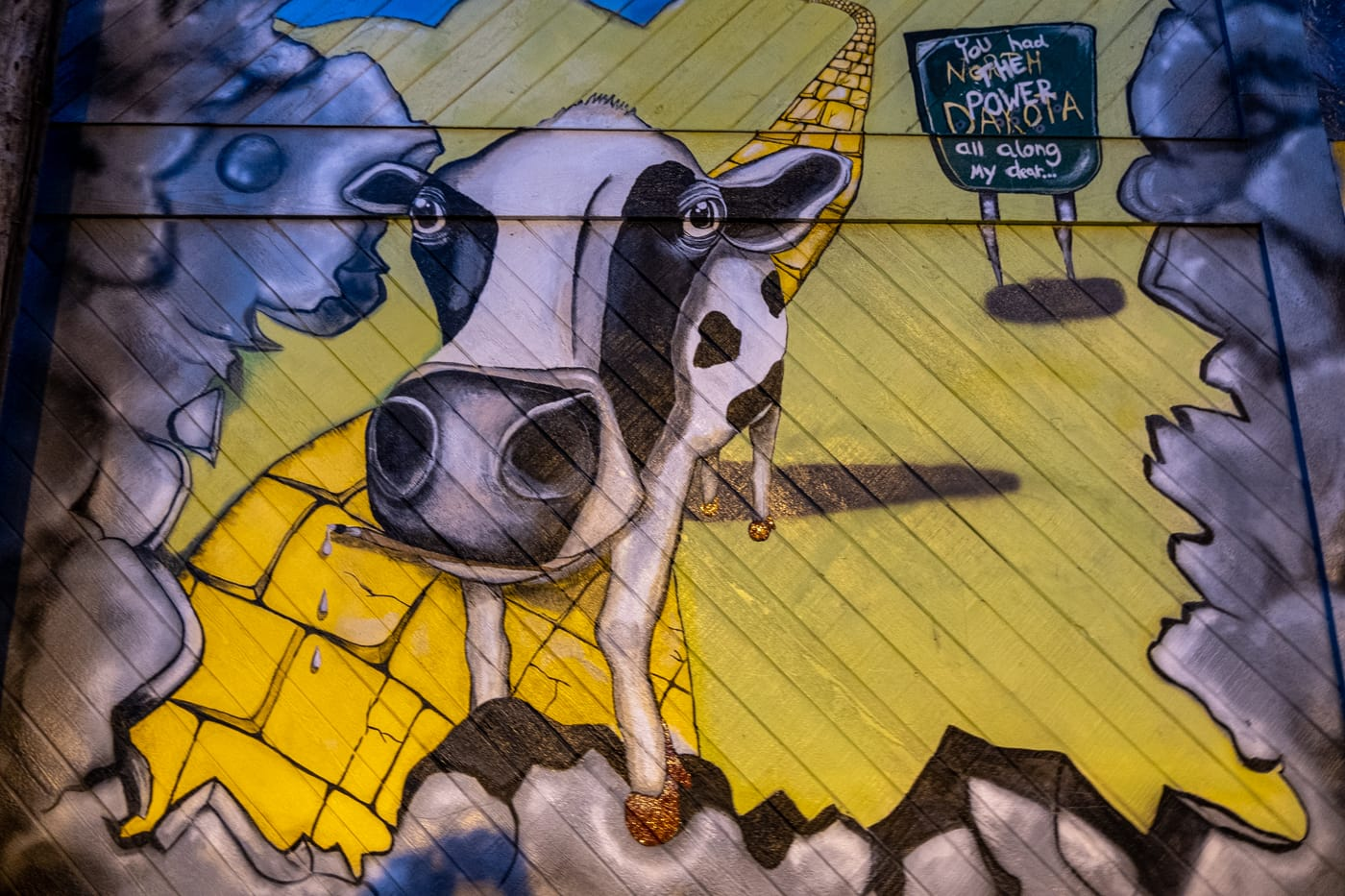 "Mahalia Mees cow meets Wizard of Oz ""Going Home"" mural declares, ""You had the power all along my dear..."" Alley 5.5: Bismarck Art Alley in North Dakota - Street art and Murals in Bismarck, North Dakota"