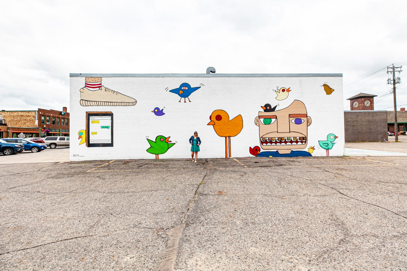 Bird Up Mural in Downtown Fargo, North Dakota by artist Hideuhs | Street Art in Fargo, North Dakota