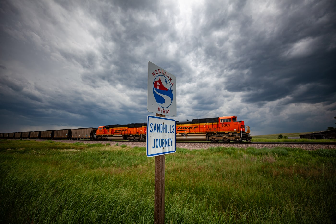 Nebraska Sandhills Journey Scenic Byway Road Sign with a train in the background