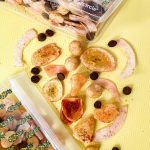 Tropical Trail Mix Recipe for a Hawaii Road Trip - Hawaiian snack mix made from dried, pineapple, banana chips, coconut chips, macadamia nuts, cacao and Li Hing Mui Powder.