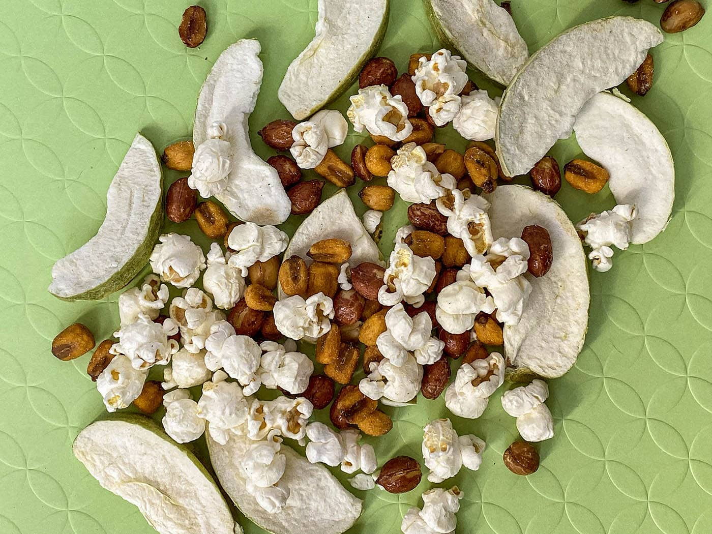 What Illinois road trip snacks should you pack for your road trip and what's in an Illinois snack mix recipe? Try these official state snacks like popcorn, corn, beer nuts, and apples.