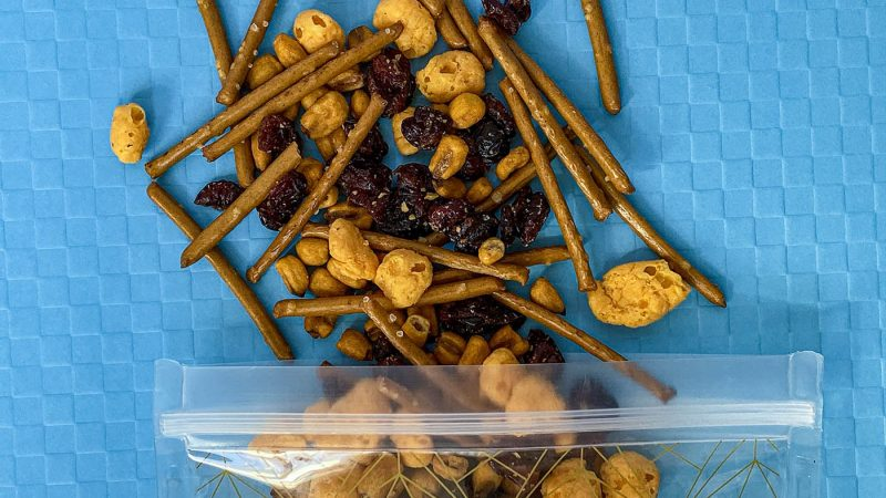 What are the best Wisconsin road trip snacks? We have them all plus the best Wisconsin recipe that snack mix combines all the flavors of the state. From cheese curds to pretzels to cranberries, this is what you should snack on in Wisconsin.