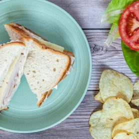 Road trip sandwiches - turkey and Swiss cheese sandwich on white bread.