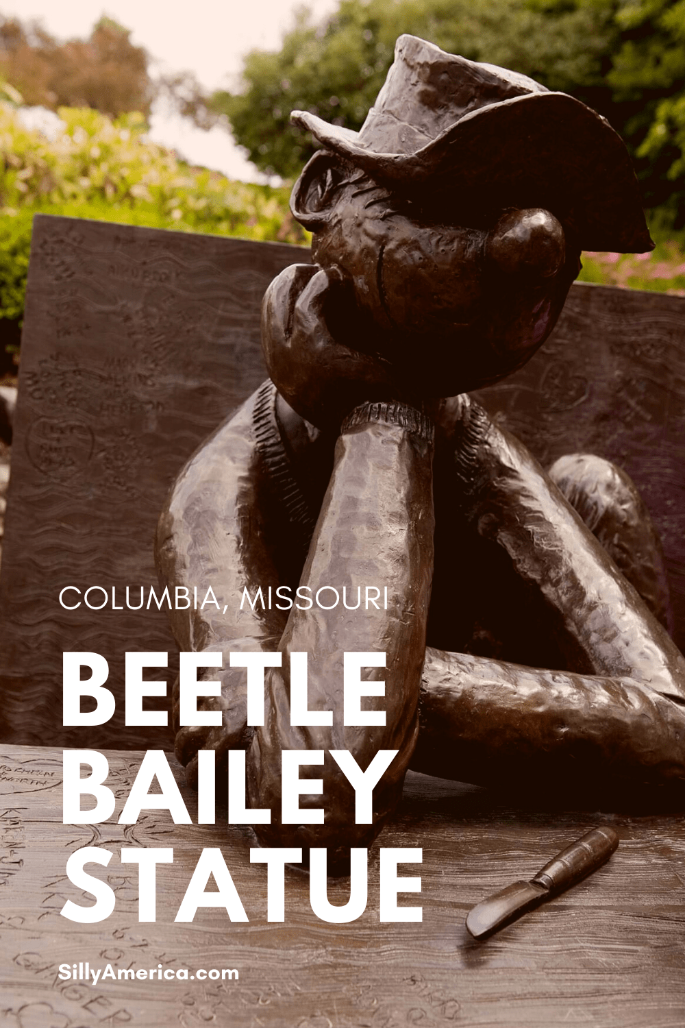 Celebrate comic strip artist and writer Mort Walker by visiting the Beetle Bailey Statue in Columbia, Missouri - a roadside attraction at the University of Missouri. #MissouriRoadsideAttractions #MissouriRoadsideAttraction #RoadsideAttractions #RoadsideAttraction #RoadTrip #MissouriRoadTrip #MissouriRoadTripMap #PlacestoVisitinMissouri #MissouriRoadTripIdeas #MissouriTravelRoadTrip #RoadsideAttraction #RoadsideAttractions