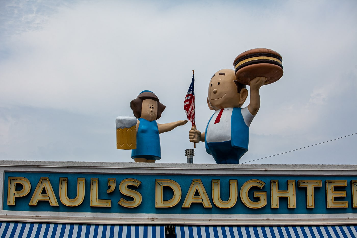 Paul's Daughter in Coney Island New York with an A&W Burger Family (A&W Root Beer Family) on the roof.